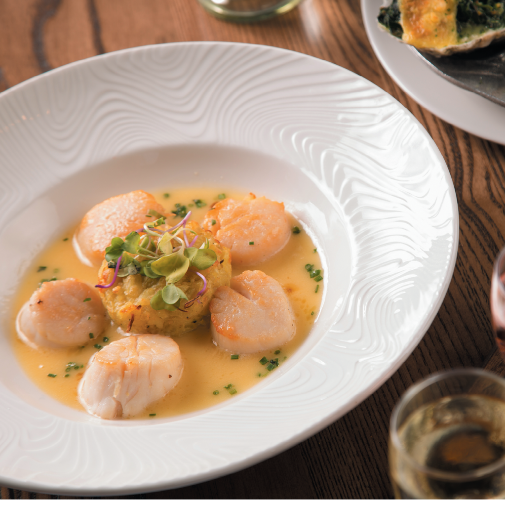"""Treasure Trove: The Oyster Rock's """"Deep Treasure"""" diver scallops with a lemongrass risotto cake is finished with its """"Chocadamia"""" dessert, featuring Ghirardelli chocolate, Maui macadamia and toasted coconut crust."""