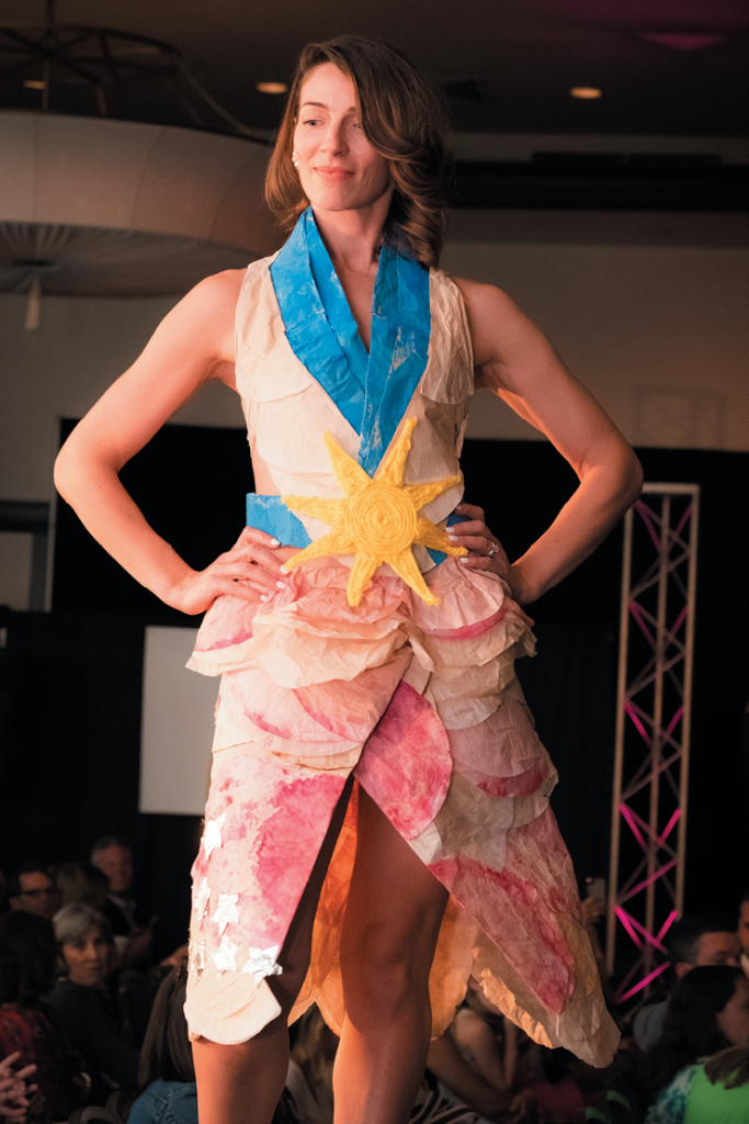 """Most Wearable """"Coffee with a Twist"""" - Designer: Laura G. Robertson, Molly Robertson and Sophia Robertson - Model: Laura Robertson - Materials: Cocktail mix, used coffee filters, paint, yarn, beet skins and juice and tin foil."""