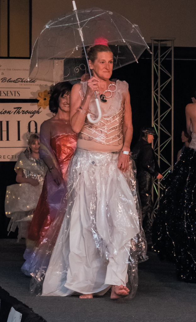 """Most Humorous """"Curtain Calls"""" - Designer: Jen Pierce - Model: Wendy Bort - Materials: Five shower curtains, shower loofahs and shower curtain rings."""