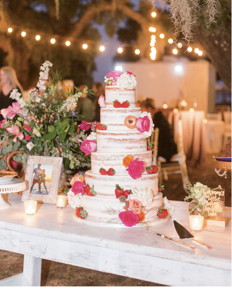 In addition to the beautiful naked cake adorned with flowers and fruit by Incredible Edibles, homemade desserts like pecan pies, Hershey bar pies and 12 layer chocolate cakes were created by the bride's mother and the couple's grandmothers