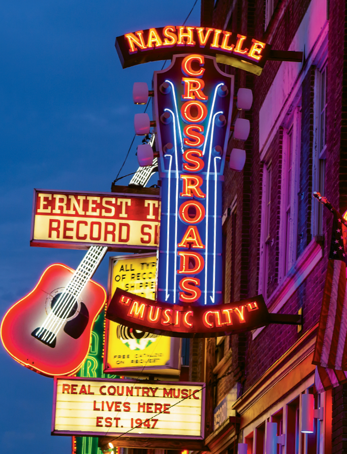 """""""Lower Broad,"""" the nickname for Nashville's Honky Tonk district, still retains some of the oldest, most iconic bars in the city."""